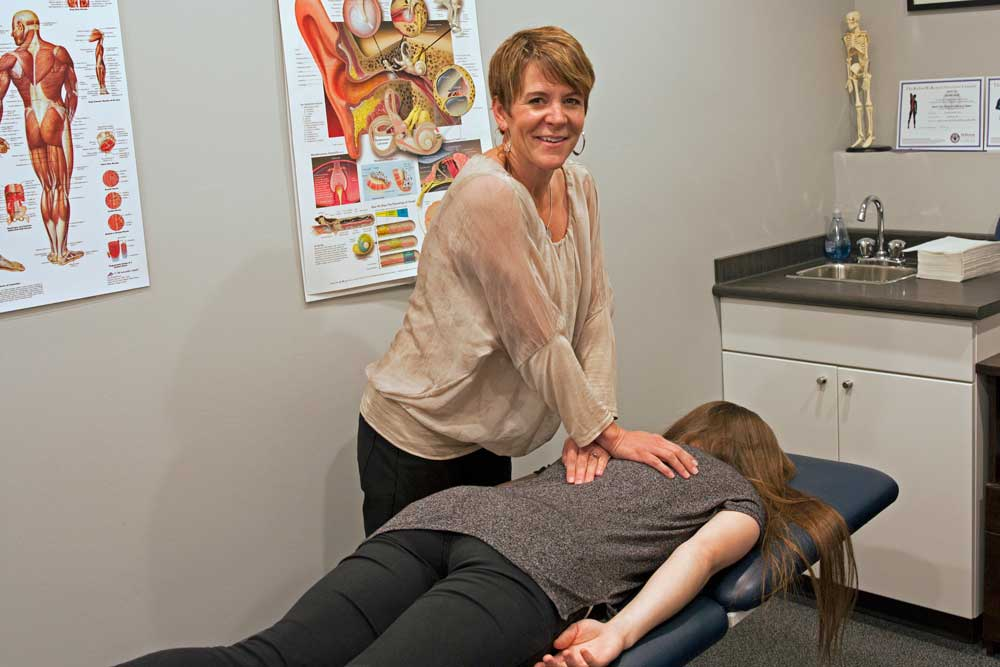 A woman receiving physiotherapy services in Saskatoon